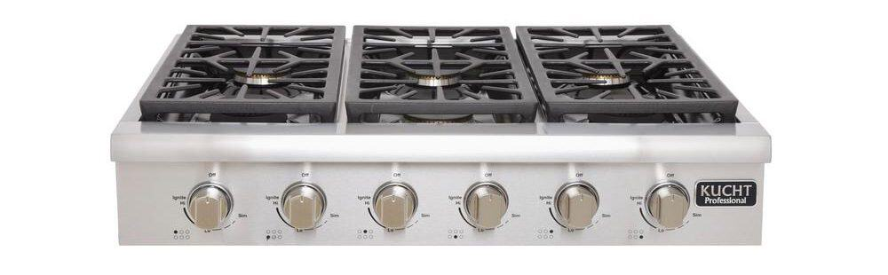 Stainless steel gas cooktop with knobs.