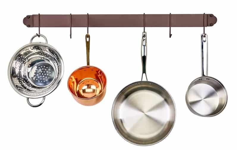 Metal, wall-mounted, straight bar pot rack with cookwares hanging.
