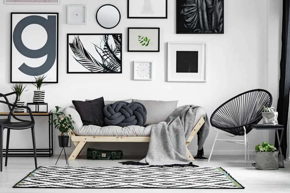 Black and white living room featuring geometric frames on the wall.
