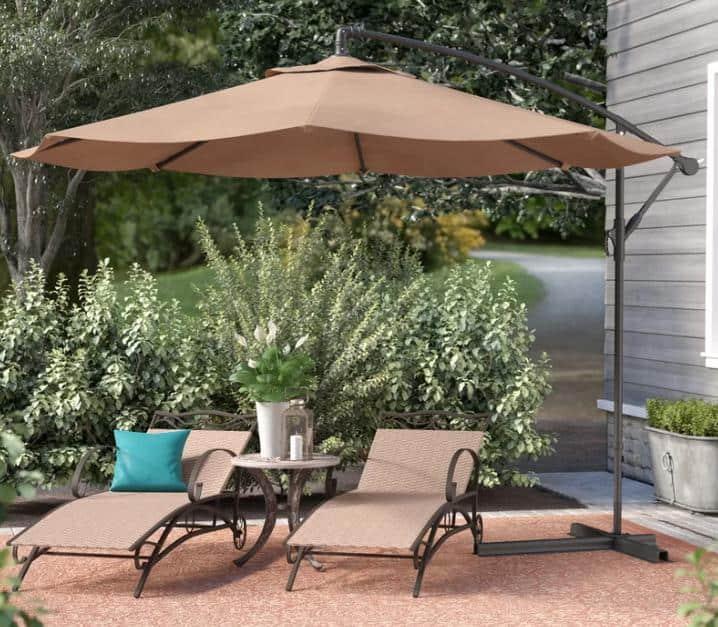 An offset patio umbrella in a Tan shade.