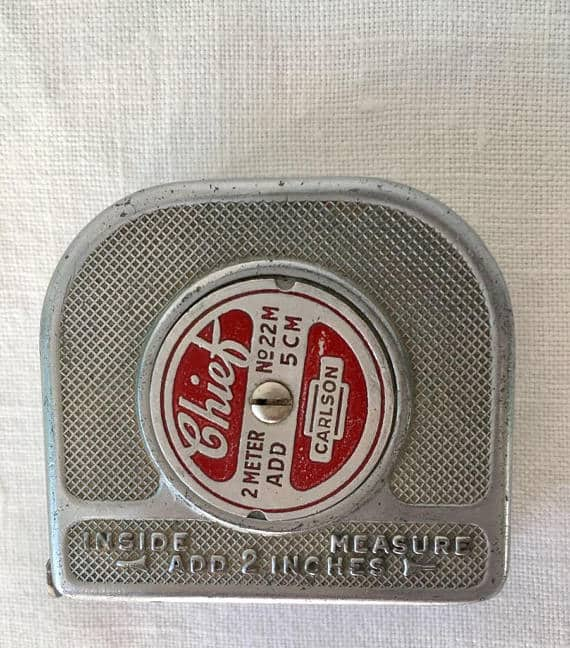 Vintage tape measure with metal case from 1940s.