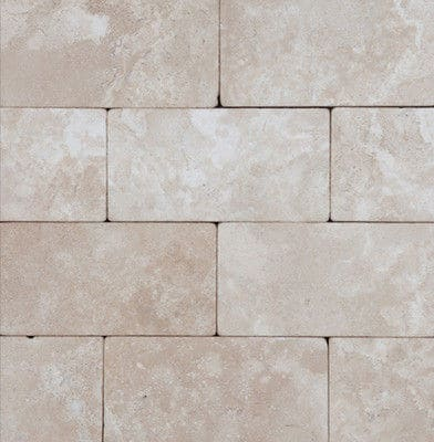 Durango cream tumbled travertine kitchen backsplash.
