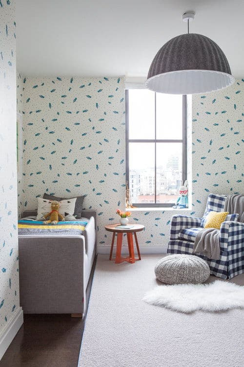 The kids room features stylish walls and a classic rug. Photo Credit: Sarah Elliot
