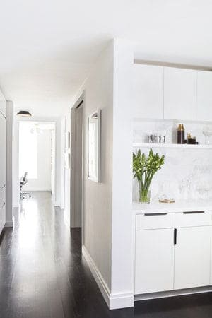 This hallway from the kitchen leads to other indoor amenities. Photo Credit: Sarah Elliot