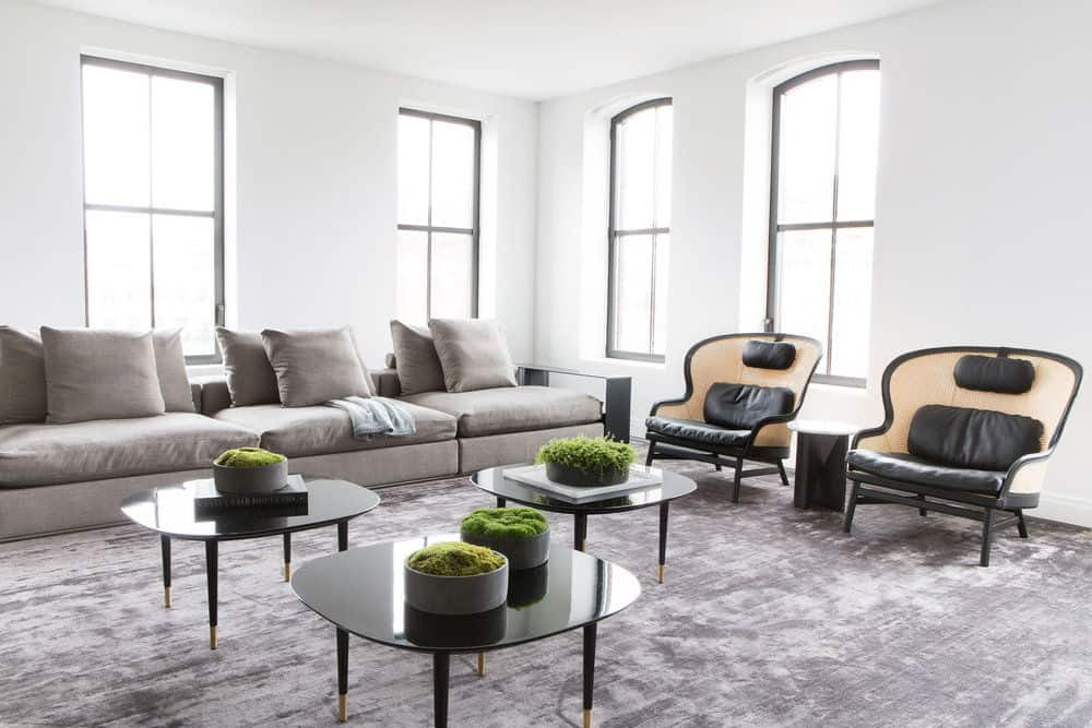 Another look of the living room focusing on its rug, tables, chairs and sofa. Photo Credit: Sarah Elliot