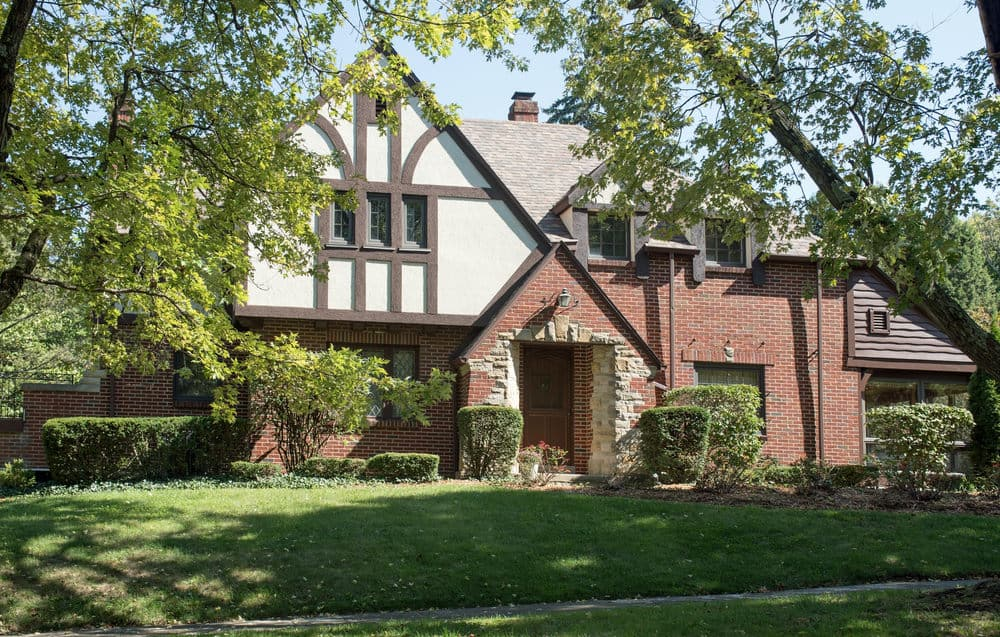 Here's a smaller Tudor style home that isn't that old. It's a simple facade and lacks the depth other Tudor styles have, but it's definitely a Tudor Revival home as a relatively new build.