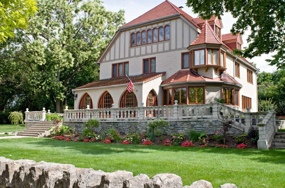 Not your typical Tudor style home but incorporates Tudor design elements on the exterior such as some half-timbering.