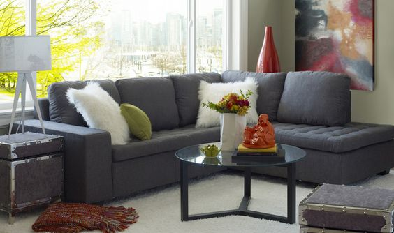 Small living room featuring a grey L-shaped sofa.