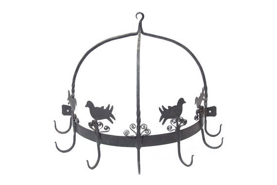 Sturdy, vintage black wrought iron pot rack with dome shape with 4 birds and metal swirls.