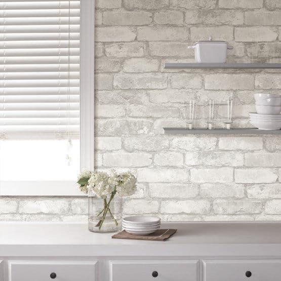 Grey and white wallpaper kitchen backsplash.
