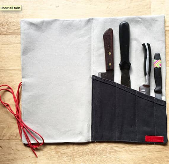 A white, bag-like knife storage made out of durable canvas.