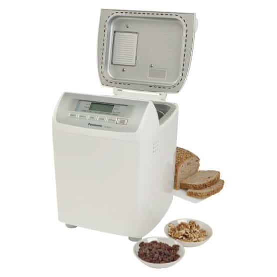 White bread maker with a dispenser of nuts and raisins.