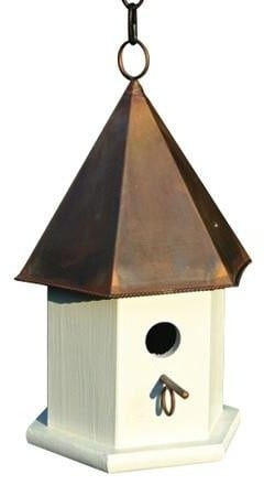 White birdhouse with a copper roof.