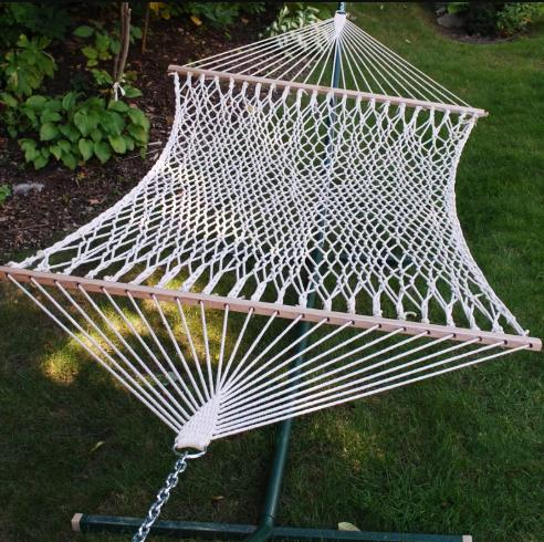 White hammock that can accommodate two people.