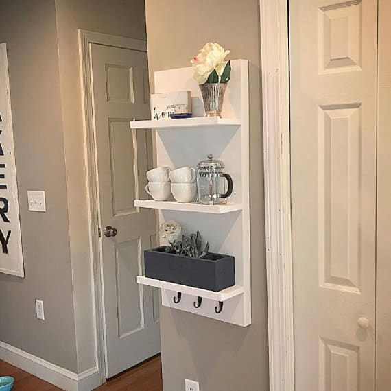 White floating shelves with hooks at Etsy