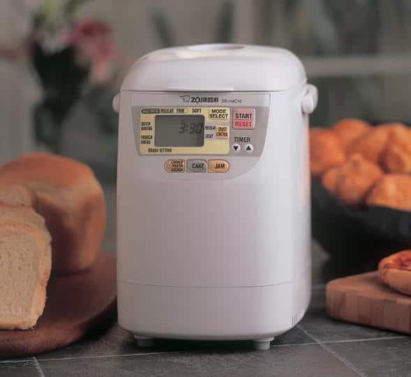 White, metal bread machine with an automatic shut-off feature.