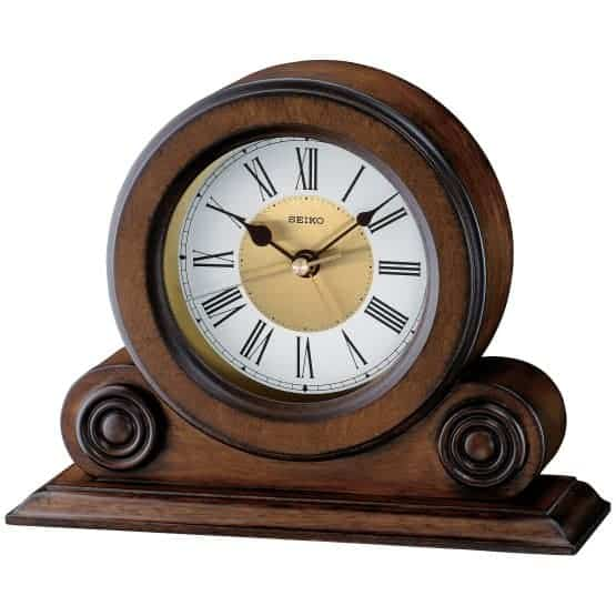Small, wooden tabletop clock.