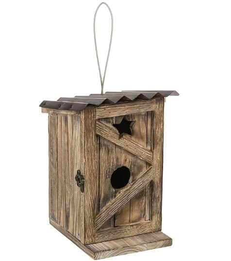 Traditional wooden birdhouse with a cute drainage.