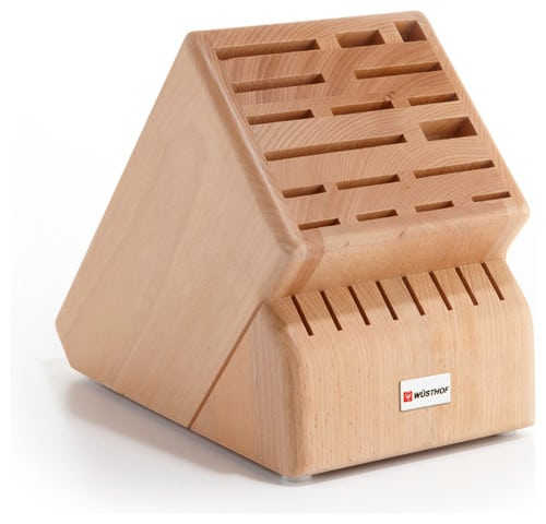 Wooden knife block with multiple slots.