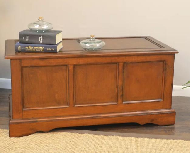 Wooden storage trunk with a Victorian finish.