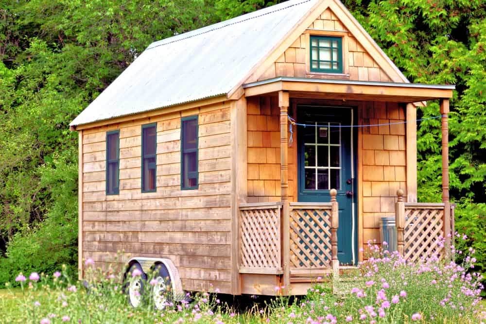 Wooden tiny home on wheels.