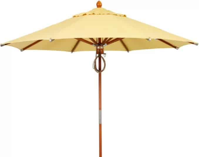 Yellow patio umbrella with a wooden base and skeleton.