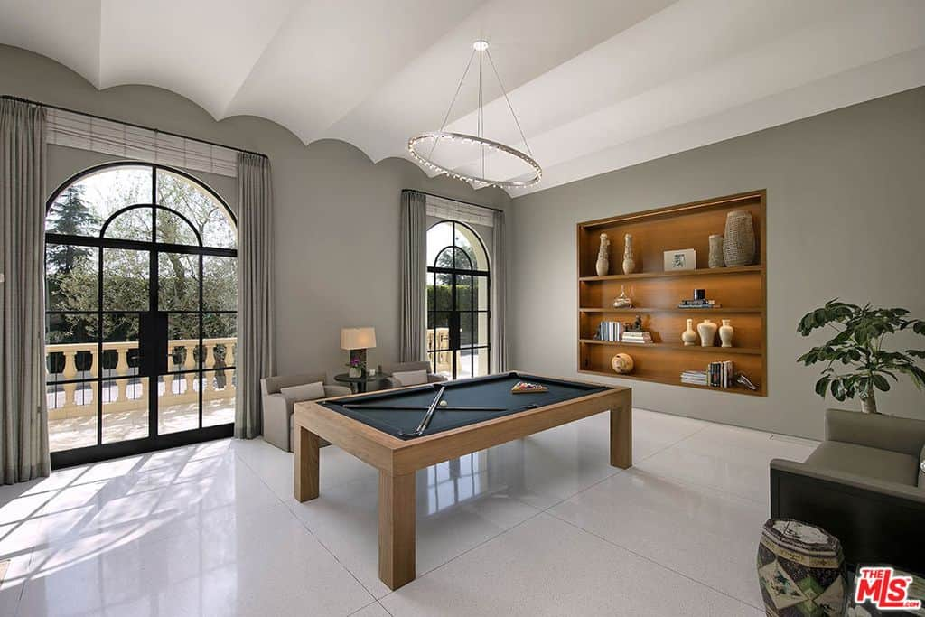 Contemporary billiards room with plenty of space to play games and relax.