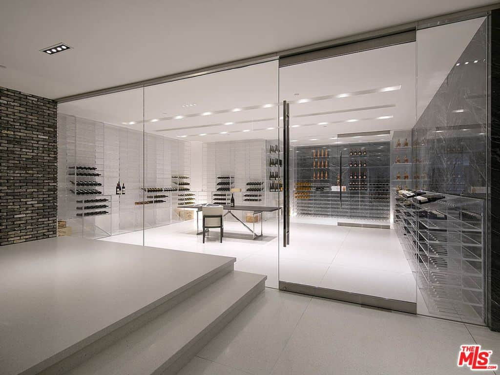 State-of-the-art wine cellar closed off behind floor-to-ceiling glass wall.