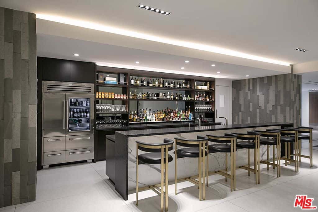 Huge home bar fully stocked and accommodates 7 bar stools