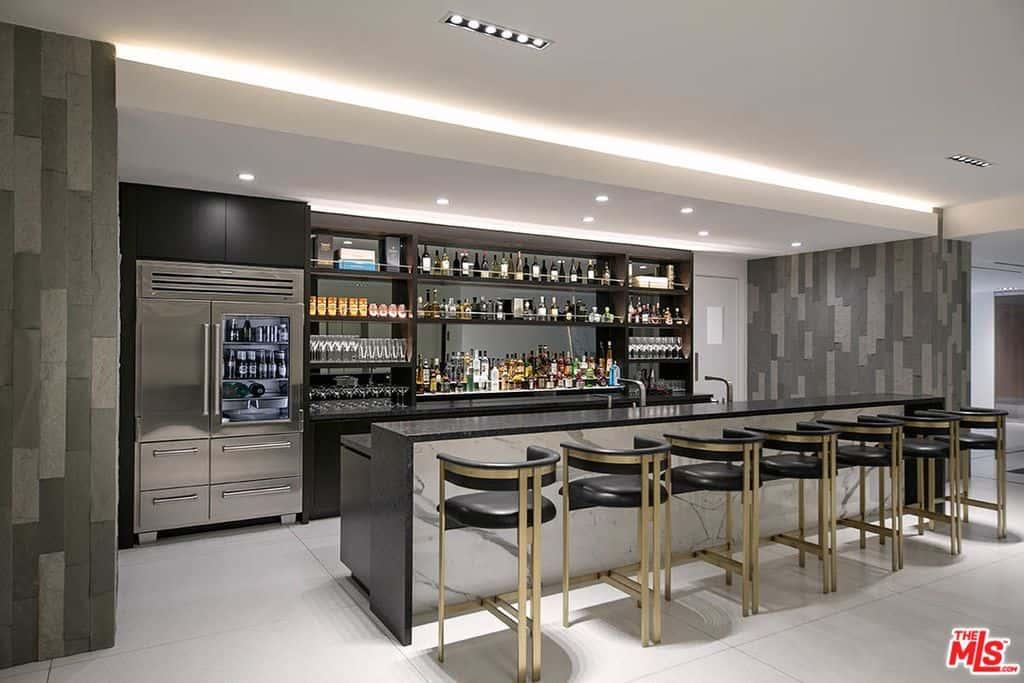 Huge home bar fully stocked and accommodates 7 bar stools