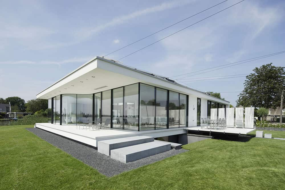 Small glass home where most of the exterior facade is essentially glass walls supported by black supports. Rest of home is all white. This is a rendering of the home, but I like the fact it's small; not huge like so many others featured here. Designed by