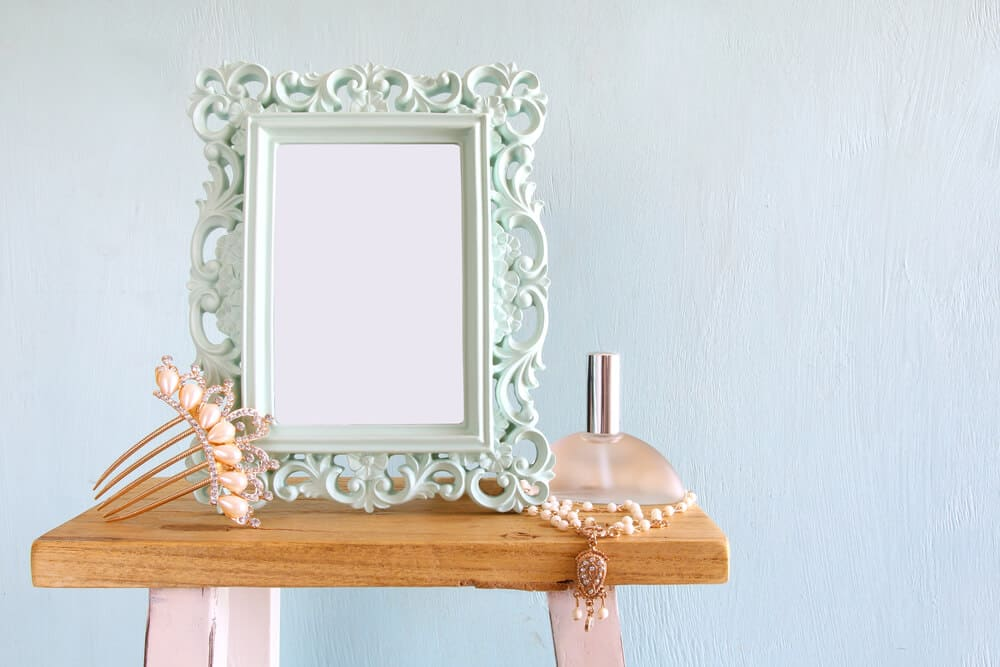 A decorative picture frame looking fancy with its design in pale blue color.