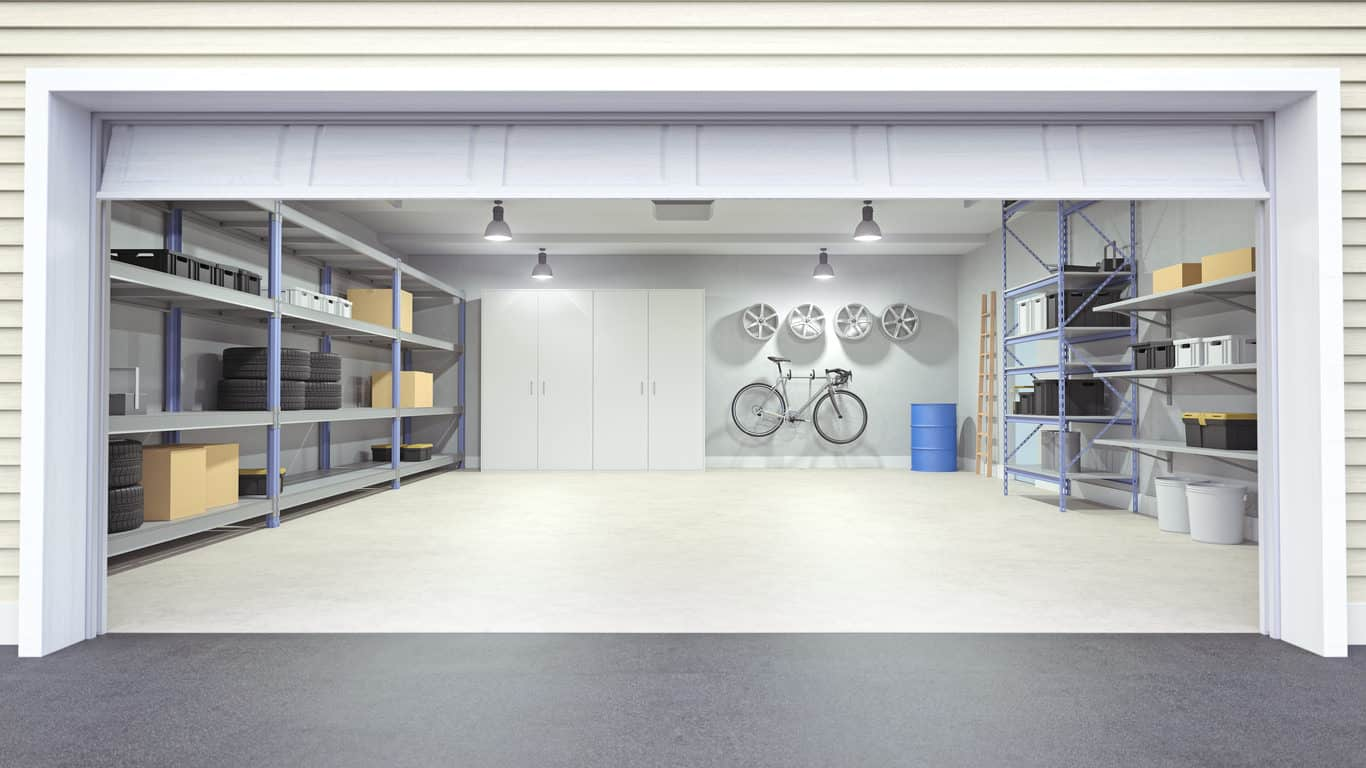Photo of a garage interior with garage door open