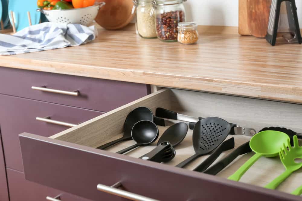Example of a well designed kitchen utensil storage drawer that is wide and shallow