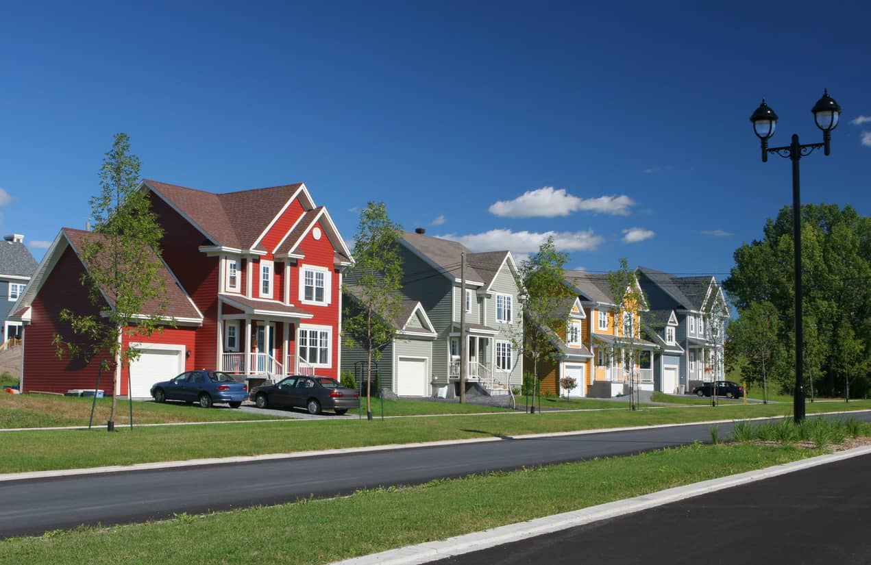 I love this photo of this suburb of colorful houses, one being bright red with white trim.