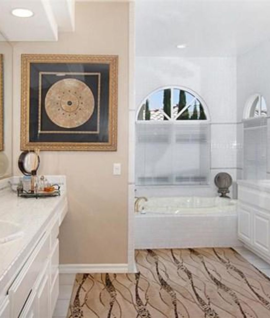 The bathroom is complete with sink, shower area and a bathtub.