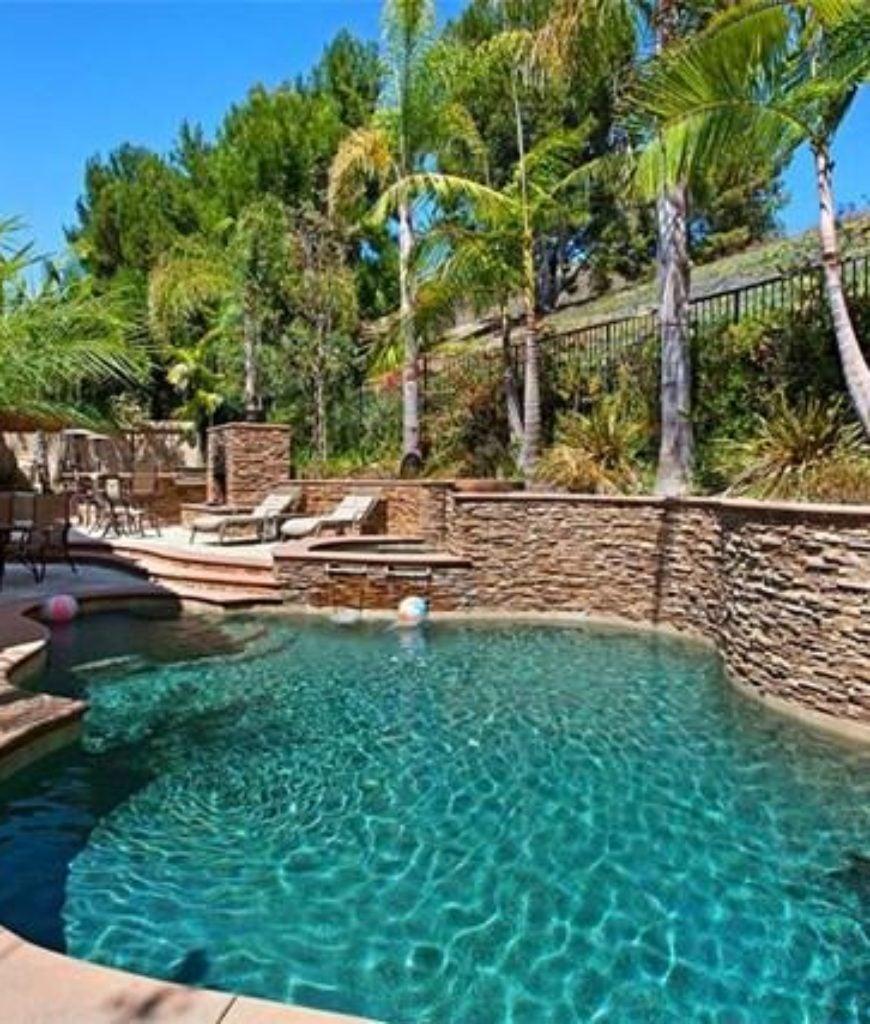 The beautiful swimming pool mirrors the California skies.