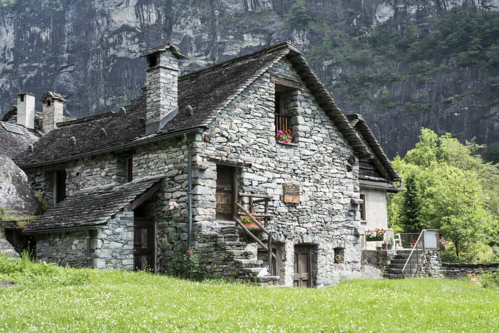 Gray house with gravel exteriors. This type of all-stone house is usually found in urban areas near the mountains or forests.