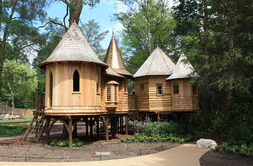 A wooden home with a tower-like design.