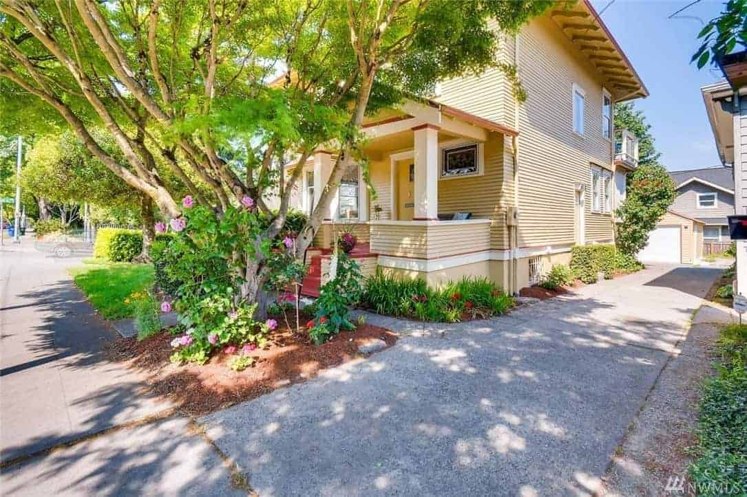 A beautifully restored craftsman home with a wooden exterior and <a class=