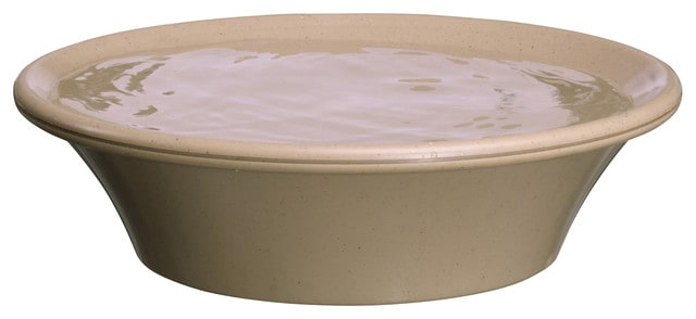 A beige bird bath with a deck mount included.