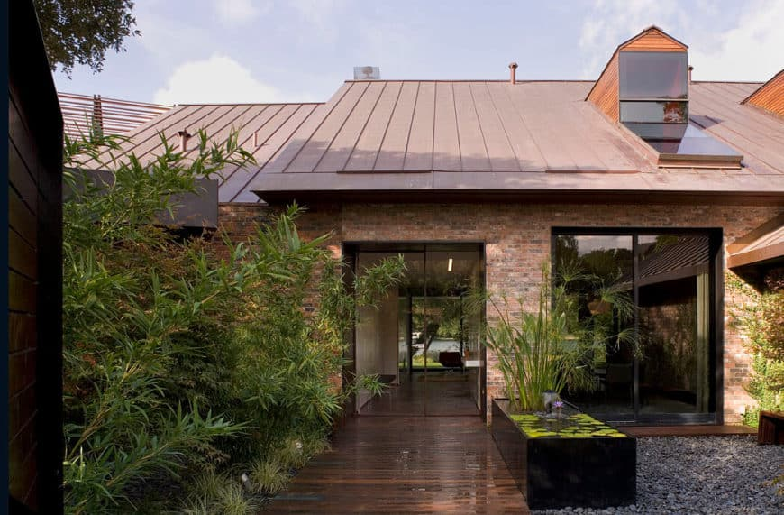 A stunning waterfront peninsula residence with a red brick exterior.
