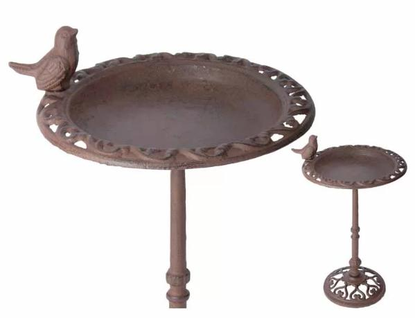 Metal bird bath with a small bird statue.