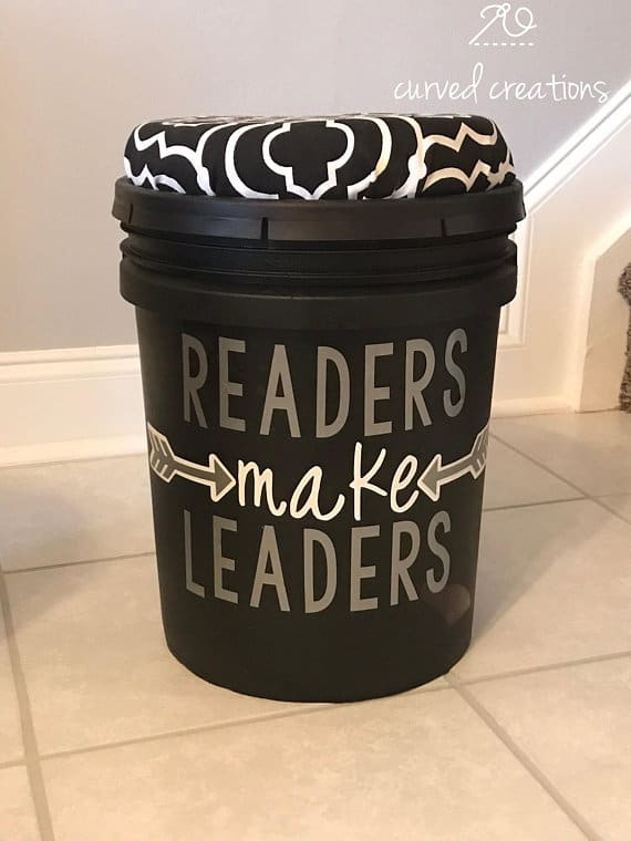A black plastic bucket with a cushion lid.