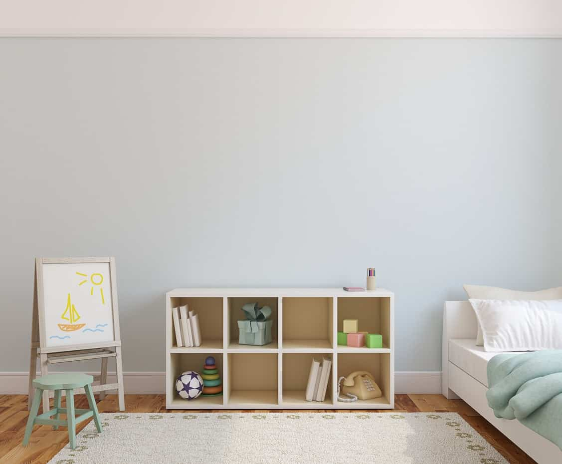 Modern kid's bedroom with an easel, stool, and an open bookshelf as nightstand alternative.