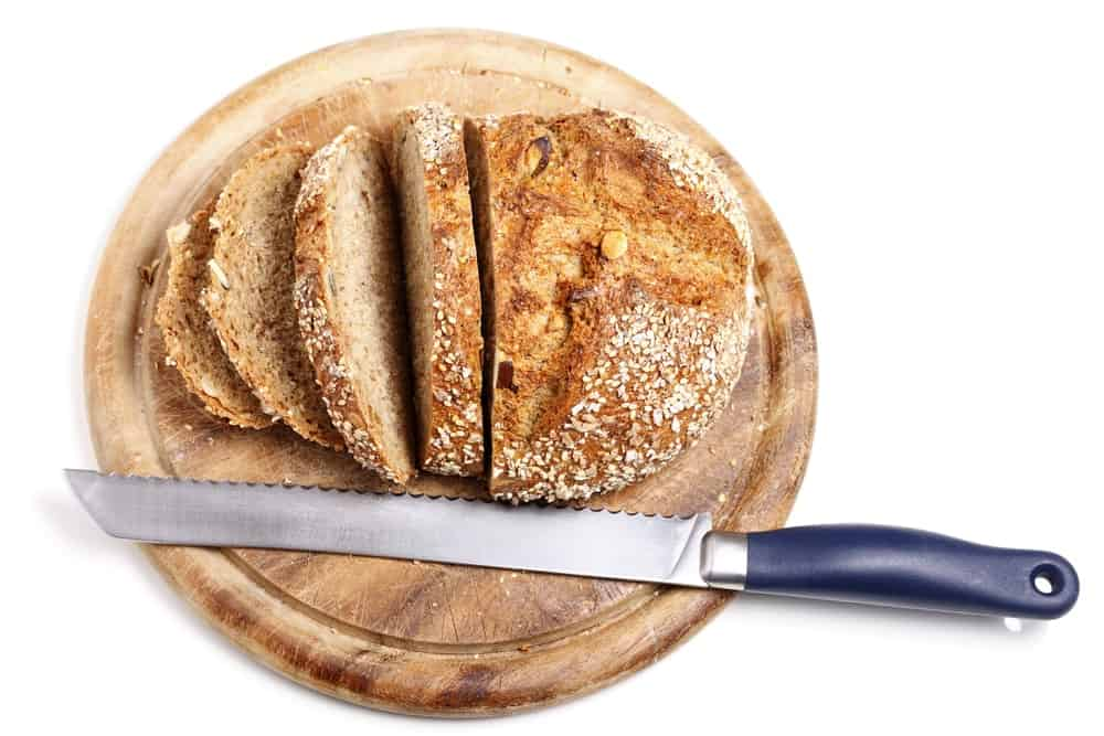 Bread knife with navy blue handle.