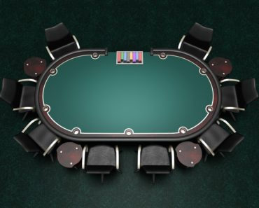 Card table with green surface for playing poker.