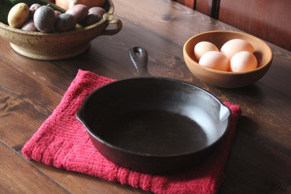 Black cast iron skillet on a table napkin.