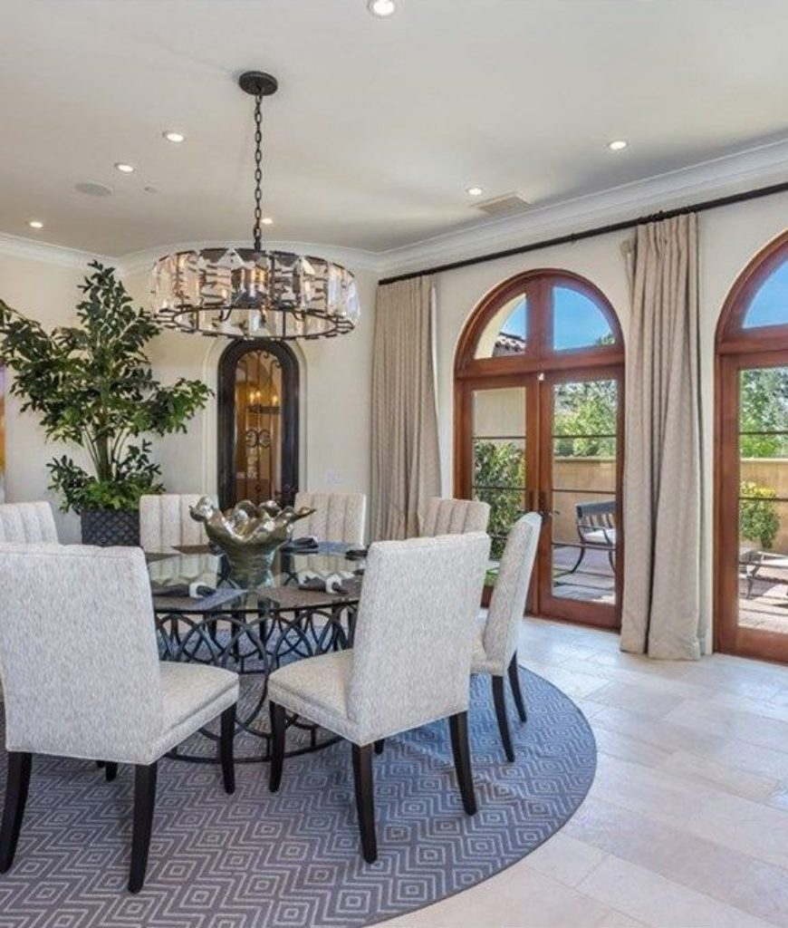 Another view of the home's dining nook featuring the scattered recessed lights and a classy chandelier.