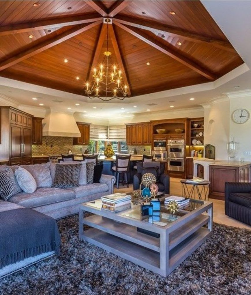 The great room offers a stylish sofa with a classy rug and center table.